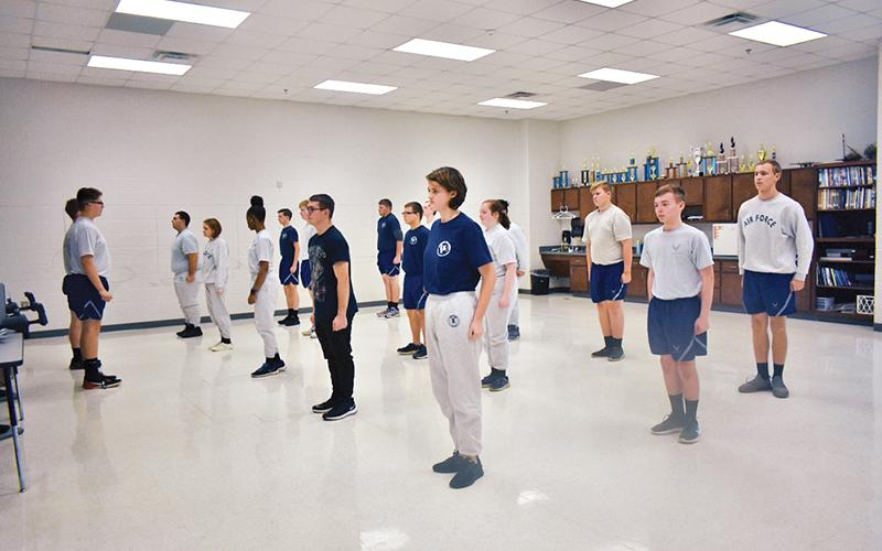 Students lead the class with stretch exercises to start off physical training, which the Air Force Junior Reserve Officer Training Corps at Habersham Central High School has every Friday.
