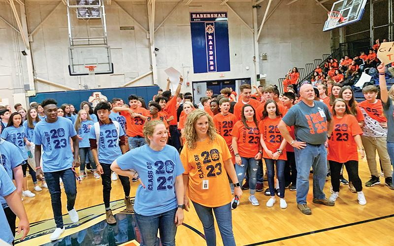 Physical education teacher Lindsay Herrin (front right) and math teacher Hannah Blalock (front left) help judge a dance competition during a Battle of the Houses at Habersham Ninth Grade Academy.