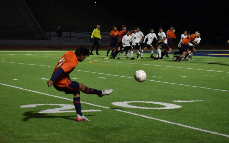Habersham Central's Yobani Alvarez sends a free kick into the box during the Raiders' 2-1 loss to Lanier High School Friday.