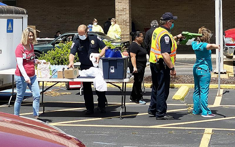 Habersham Medical Center personnel and county first responders held a drive-through COVID-19 testing event in Cornelia on Sunday. CODY ROGERS/Staff