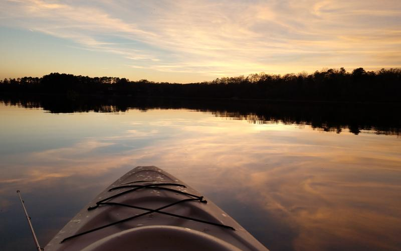 Michael Hall / Seen from a kayak, Lake Hartwell is beautiful in the sunset.