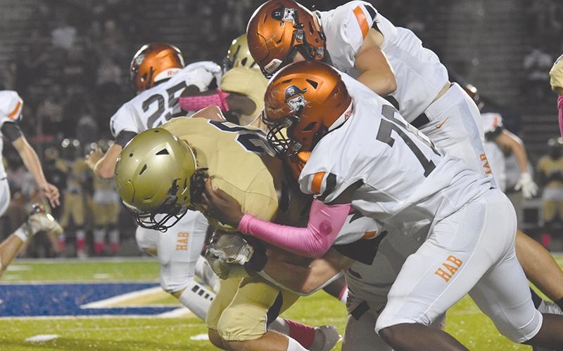 Habersham Central's Alex Aaron leads a tackle of a Dacula ballcarrier during Friday's game. LILLIAN VANTASSEL/Special