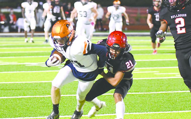Habersham Central's Austin Wood looks to break free of Winder-Barrow's Alex Cha during Friday night's game. TOM ASKEW/Special