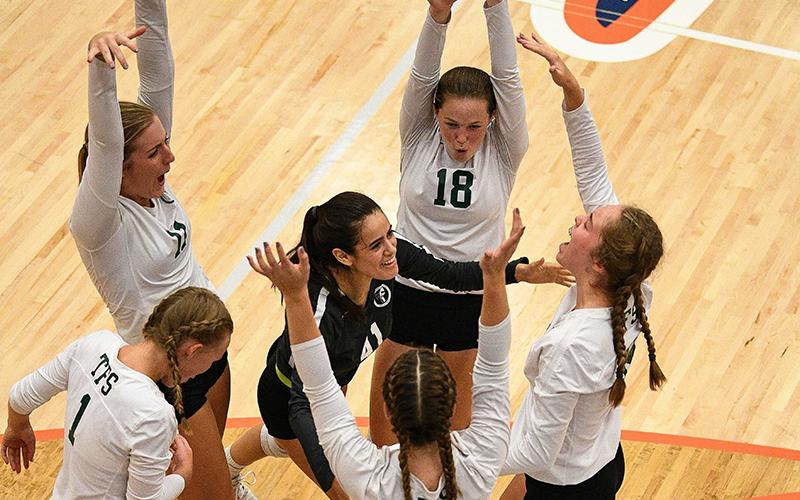 Tallulah Falls' volleyball team celebrates a point during their win Tuesday. BRIAN CARTER/Special