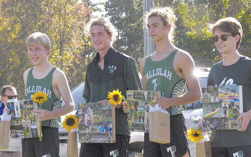 From left are Tallulah Falls senior runners Collin Kelly, Eli Sims, Grey Bourlet and Chaz Mullis, who were recognized at Tuesday's home meet. BRIAN CARTER/Special