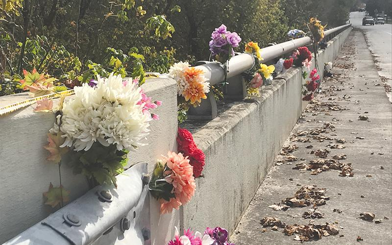 Members of the Clarkesville community left flowers on the Homer Sutton Bridge on Highway 197 in memory of Shane Justice earlier this week.