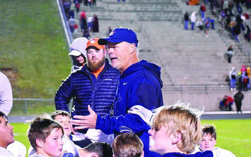 Habersham middle school football coach Mark Ausburn talks with his team after winning the league championship on Nov. 2.