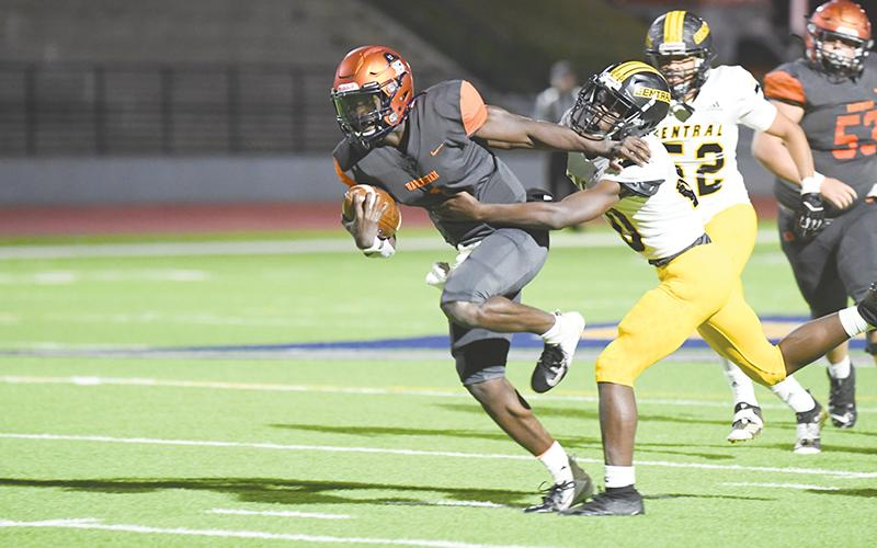 Habersham Central's Joshua Pickett does a Heisman stiffarm to bypass a Central  Gwinnett tackler on Tuesday night. TOM ASKEW/Special