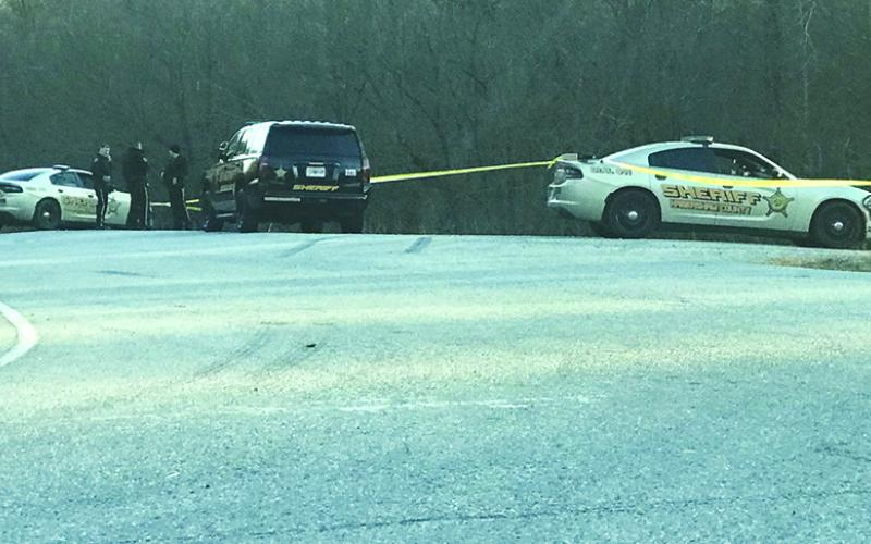 Habersham County Sheriff's deputies gather near the White County line on Highway 115 Monday afternoon to investigate a shooting.