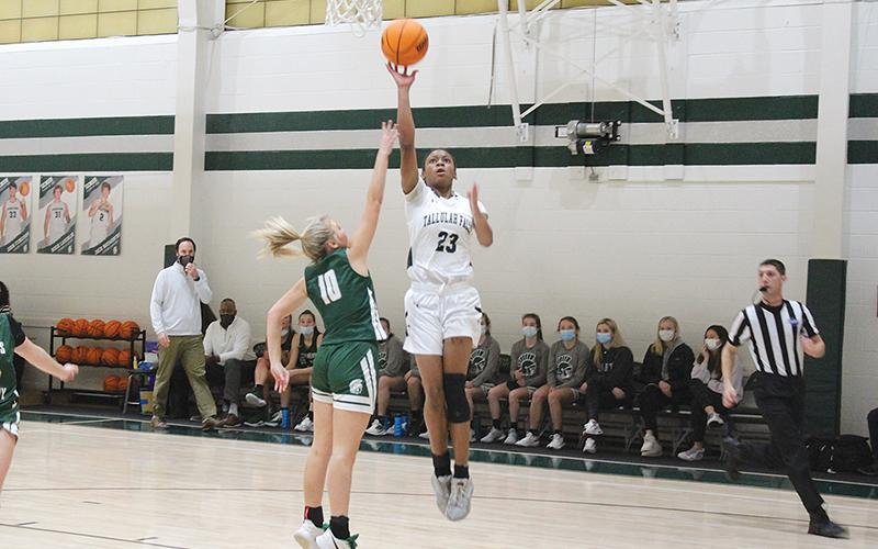 Denika Lightbourne elevates for a layup in Tallulah Falls' 10-point loss to Athens Academy in the region championship. The sophomore finished with a team-high 20 points in the loss.