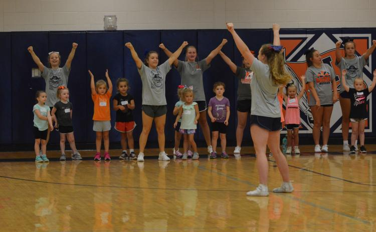 Campers perform a cheer at the beginning of the Future Lady Raiders Cheerleading Camp Tuesday.