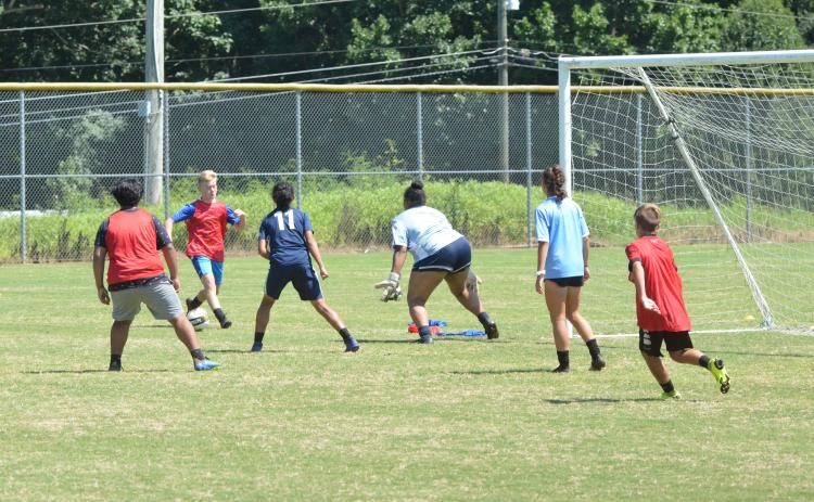Campers scrimmage at the Future Raiders Soccer Camp Wednesday. (Zack Lee/Staff)