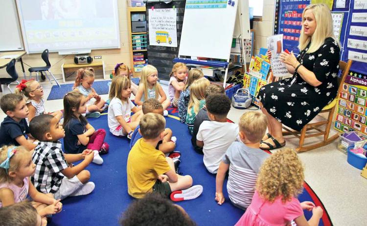 "Habersham County Schools, along with the thousands of students who attend them, returned to ""class as usual"" Wednesday, Aug. 7. Shown is Clarkesville Elementary School kindergarten teacher Kristi Thurmond explaining classroom conduct to her students the morning of the first day of school. Prior to the first day, students and their parents/guardians turned out for open houses earlier this week. For additional back-to-school photos, see Page 6A, this edition."