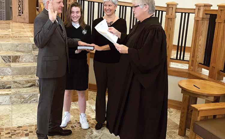 Newly elected District 5 Habersham County Commissioner Tim Stamey is sworn in Monday at Tallulah Falls School along with daughter Sam Stamey, wife Kerry Stamey and Habersham County Probate Judge Pam Wooley.