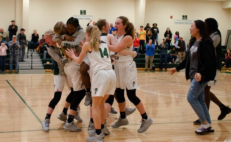 The Lady Indians celebrate after beating Paideia High School 51-50 in the first round of the Georgia High School Association state basketball tournament Friday.