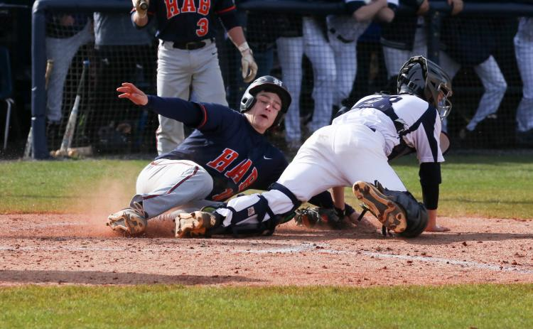 Habersham Central's Christian King (10) slides into home plate during the Raiders' 6-3 win over White County High School Saturday in Cleveland.