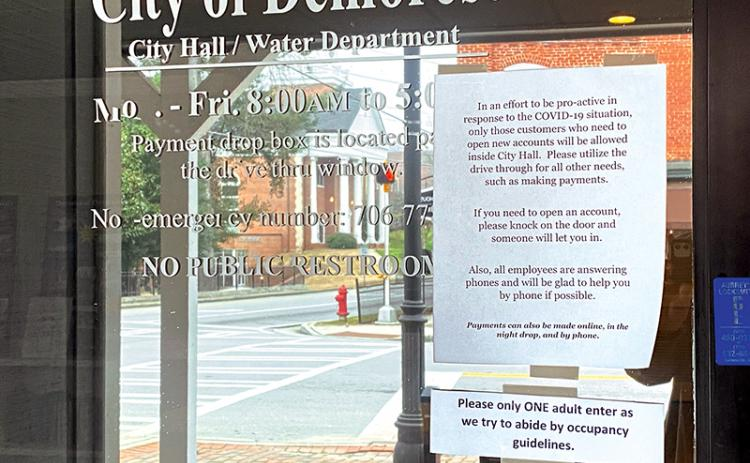 Instructions at Demorest's City Hall echo others around the county trying to keep residents and city employees safe.