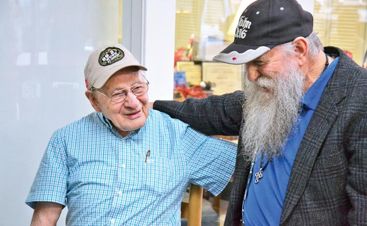 Billy Burrell (left) shares a laugh with John A. Harris at his birthday party on Friday morning.
