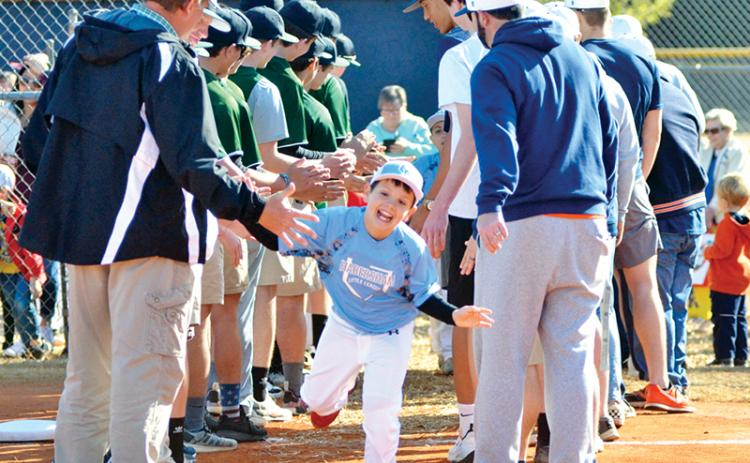 Easton Martin high-fives Tallulah Falls School and Habersham Central High School players during HCLL Opening Day in 2019.