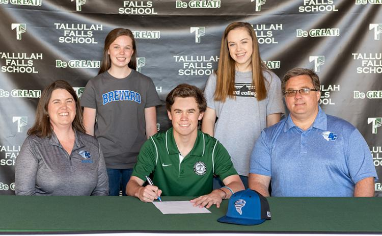 Tallulah Falls School senior Davis Jennings of Clarkesville on April 2 signed a letter of intent to compete in baseball for the Brevard College Tornados. Shown (back row from left), are Sarah Jennings and Rebekah Jennings. Front row (from left) are Jennifer Jennings, Davis Jennings and James Jennings.