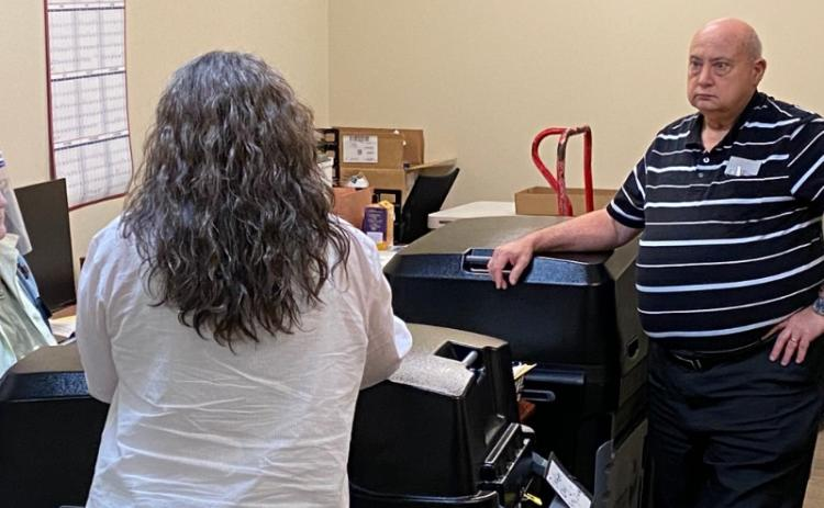 Board of Elections Chairman Carroll Jeffers and Elections Supervisor Laurel Ellison count the ballots stuck in the voting machines of the June 9, 2020 recount.