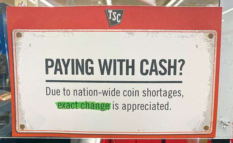 A sign at Tractor Supply in Cornelia lets folks know they are short on change.