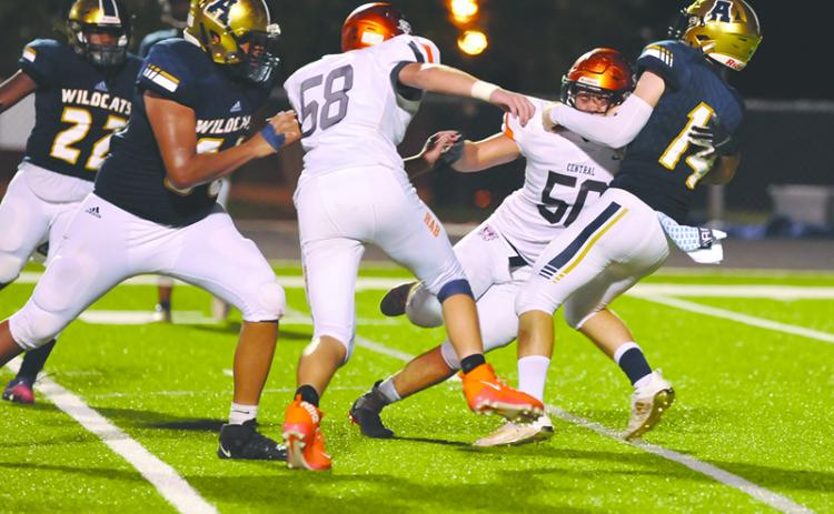 Habersham Central's Tanner Wade (50) and Jonathan Adams (58) put pressure on Apalachee quarterback Todd Jones during a win on Sept. 11. TOM ASKEW/Special