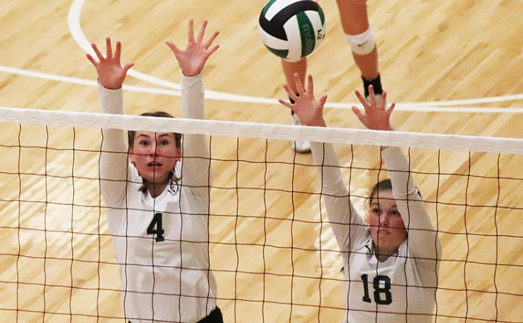 Tallulah Falls' Abby Carlan (4) and Sarah Jennings elevate for the block during a recent match. BRIAN CARTER/Special