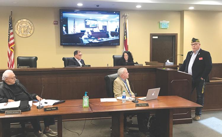 VFW District Commander Bill Miles talks at Monday's Habersham County Board of Commissioners meeting. Listening are Commissioners Jimmy Tench and Tim Stamey (bottom row), Stacy Hall and Natalie Crawford (top row).