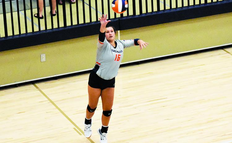 Habersham Central's Maddie Chosewood serves during Tuesday's match. ISAIAH SMITH/Staff