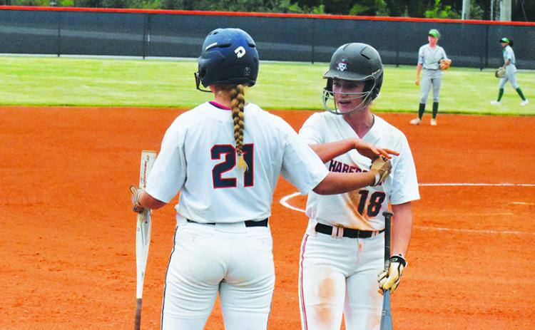 Habersham Central's Taylor Wade and Preslee Hix celebrate a run against Buford on Sept. 16. CODY ROGERS/Staff