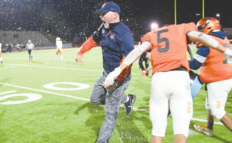 Habersham Central coach Benji Harrison celebrates after having Gatorade poured on him following the Raiders' win over Lanier. TOM ASKEW/Special