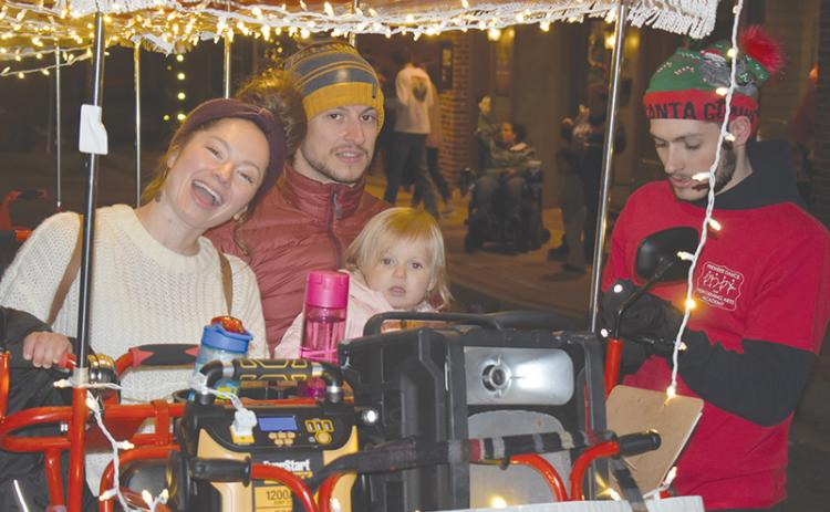 Jessica and Chris Gneiding took their little ones Anneliese (shown) and Lucas on the pedal cart at the Downtown Christmas event in Cornelia on Saturday.