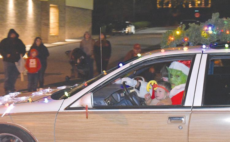 Joel Alexander and daughter Laikyn channel the Grinch and his pal Max.