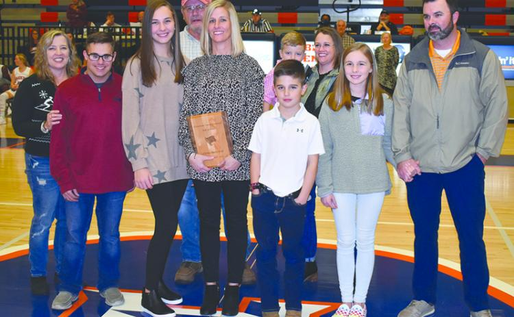 Christy Keef was joined Friday night during her induction by (front row, from left) Tammy Harris; children Carlin Fricks, Camryn Fricks, Kyler Keef and Katie Keef; and husband Dan Keef. In back are (from left) Alex Harris, Garrison Stamey and Valerie Stamey.