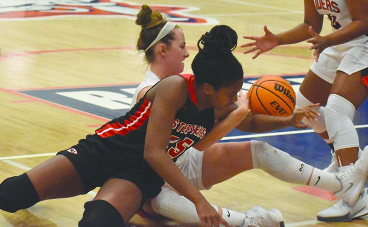 Habersham Central's Taylor Wade battles Stephens County's Ranjah Verdell for a loose ball during Friday night's game.