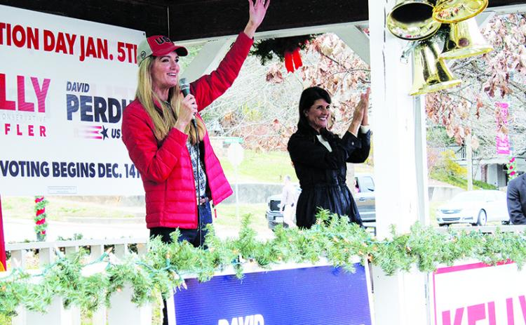 U.S. Sen. Kelly Loeffler waves acknowledges applause from a crowd of 250-plus on the second stop of her statewide firewall tour Sunday in Demorest. Loeffler was joined by former U.N. Ambassador Nikki Haley (right) for each of her stops throughout the day.
