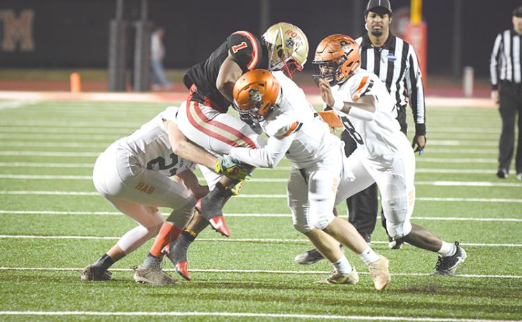 Habersham Central tacklers (from left) Grayson Taylor, Patrick Tedder and Alex Aaron  converge on Rome's EJ Lackey during Friday's playoff game. TOM ASKEW/Special
