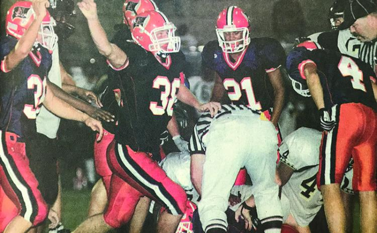 Habersham Central's Marty Patterson (38) celebrates along with teammates after a big stop during a 2006 game.