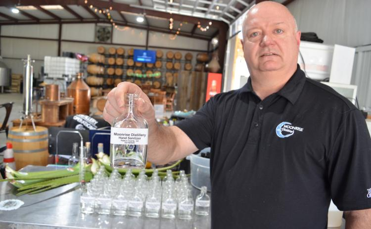 Wayne Knuckles/The Clayton Tribune. Moonrise Distillery in Clayton was one of the first craft distilleries in the nation to convert production to hand sanitizer during the COVID-19 health emergency. Owner Doug Nassaur said Moonrise will continue to make bottles of sanitizer available to local residents as long as it is possible to do so.